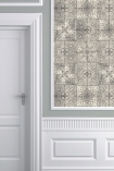 lifestyle image of Louise Body Patchwork Tea Tile Wallpaper - SAMPLE with white doorway