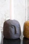 Image of the Alfie Quirky Face Candle Holder In Black with a candle in him