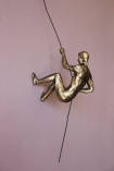 Image of the Left Handed Abseiling Man In Antique Gold