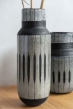 Image of the Tall African Tribal Inspired Vase with the short version in the background