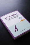 lifestyle image of cover of 101 Things To Do When You're Not Drinking on black table background