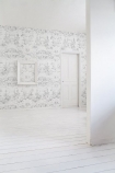 lifestyle image of Young & Battaglia Vintage Delf Wallpaper - Almost White in white room with white wall and white door