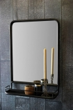 Antique Brown Mirror With Shallow Shelf - Portrait on dark wooden wall with tall candle and small pots lifestyle image