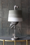 lifestyle image of Antique Silver Flamingo Table Lamp With Khaki & White Shade on gold table with grey tiled wallpaper background