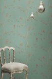 lifestyle image of Barneby Gates Wallpaper - English Robin - Jade with white chair and two bulb ceiling lights