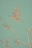 detail image of Barneby Gates Wallpaper - English Robin - Jade pink and white birds and branches on green toned background