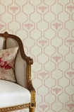 detail image of Barneby Gates Honey Bees Wallpaper - Rose On Stone with cream and gold sofa and pink patterned cushion