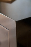 Close-up of the corner on the Oriental Gloss Black Bedside Table