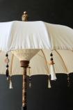 lifestyle image of Boho Beaded Cotton Garden Umbrella on dark wall background