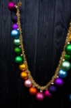Lifestyle image of one loop of the Large Rainbow Baubles & Tinsel Garland
