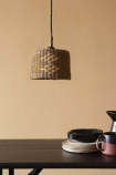 Lifestyle image of the Brown, Natural & Grey Rope Lamp Shade over a dining table with tableware on it with cloisters painted wall background
