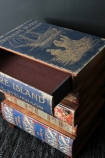 detail image of drawer open on Treasure Island Book Chest Of Drawers  Bedside Table on dark wooden flooring and dark grey wall background