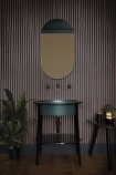 lifestyle image of Cole & Son Marquee Stripes Collection - College Stripe Wallpaper - 2 Colours Available with green sink and plant with oval wall mirror above
