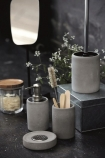 lifestyle image of Concrete Toothbrush Mug in bathroom with other concrete bathroom accessories