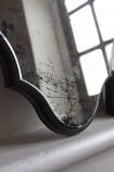 Close-up image of the bottom of the Vintage Style Foxed Wall Mirror
