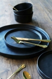 lifestyle image of Faria Dinner Service Collection - Black on wooden table