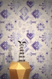 lifestyle image of Feathr Watercolour Gems Wallpaper - Purple with gold side table and vases on top