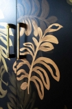 Close-up image of the design on the Hand-Painted Tropical Leaf Sideboard