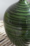 Close-up image of the detail on the Glazed Green Bottleneck Vase