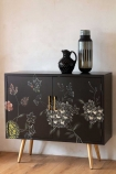 Angled lifestyle image of the Hand-Painted Dark Florals Sideboard