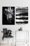lifestyle image of Unframed Haze Art Print hung on white wall with second print above white desk with wheels and grey ch\air