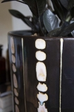 Close-up image of the spot detail on the Large Ceramic Stripe & Spot Pot Planter With Feet