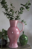 Close-up lifestyle image of the Tall Pink Glazed Jug Style Vase With Handle