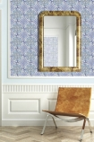 lifestyle image of Louise Body Old Blue Tile Wallpaper - Panel with brown chair and wall mirror
