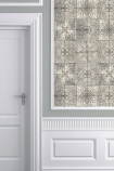 lifestyle image of Louise Body Patchwork Tea Tile Wallpaper - Panel with white doorway