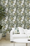 lifestyle image of Mind The Gap Exotic Fruit II Wallpaper with large plant and white sofa with tropical printed cushion