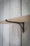 detail image of bracket on Oak Shelf With Cast Iron Brackets - Large on white wood panel wall background