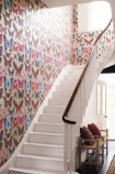 lifestyle image of Osborne & Little Butterfly House Wallpaper with large white staircase