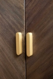 Close-up image of the handles on the Parquet Style Wooden Sideboard Unit