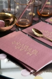 Lifestyle image of the Pack Of 20 Pretty Berry Pink Paper Napkins with Gold Print
