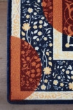 detail image of corner of Autumn Morning Rug 250cm X 150cm on grey flooring