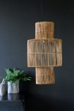 Rattan Lamp Shade with desk and plants on dark background lifestyle image