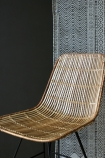 Blonde Rattan Dining Chair close up of seat lifestyle image