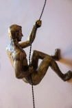 Close-up image of the Left Handed Abseiling Man In Antique Gold