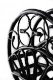 Close-up of the Black Cane Magazine Rack on a white background