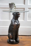 Lifestyle image of the Black Panther Side Table With Glass Top with a vase on top