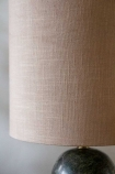 Close-up image of the shade on the Forest Green Marble Table Lamp With Natural Lamp Shade