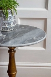 Close-up image of the Vintage Marrakesh Brass & Marble Side Table