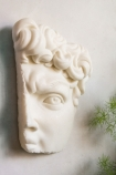 Image of the Fragment Of Michelangelo's David Wall Art hanging on the wall