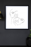 Lifestyle image of the White Lovers Art Print hanging on a wall framed