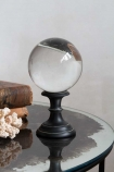 Lifestyle image of the Crystal Ball Ornament Displayed On A Small Base