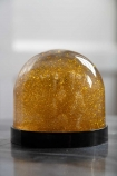 Image of the Gold Eskimo Kiss Snow Globe with the glitter mixed in the globe