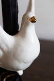 Close-up image of the head on the Hand Painted UK Made White Dove Symbol Of Peace Candle Holder