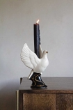 Lifestyle image of the Hand Painted UK Made White Dove Symbol Of Peace Candle Holder
