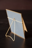 lifestyle image of the back of the lightening bolt desk mirror on black desk with dark wall background