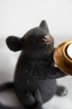 Close-up image of one of the Black Mouse Candle Holder